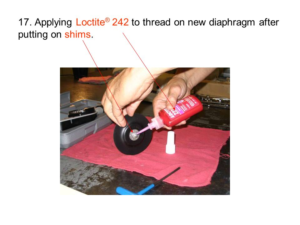 17. Applying Loctite® 242 to thread on new diaphragm after putting on shims.