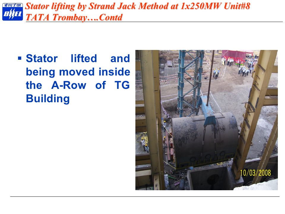 Stator lifted and being moved inside the A-Row of TG Building