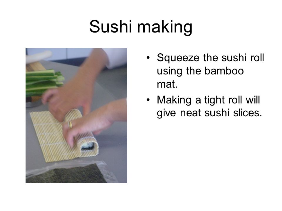 Sushi making Squeeze the sushi roll using the bamboo mat.