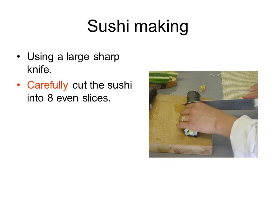 Sushi making Using a large sharp knife.