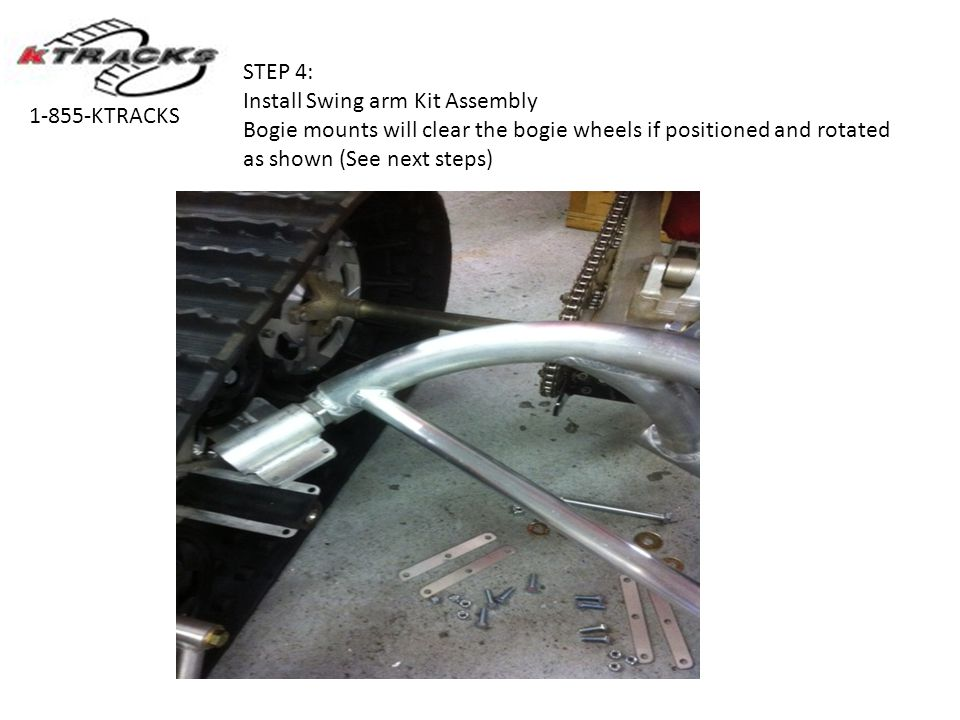 STEP 4: Install Swing arm Kit Assembly. Bogie mounts will clear the bogie wheels if positioned and rotated as shown (See next steps)