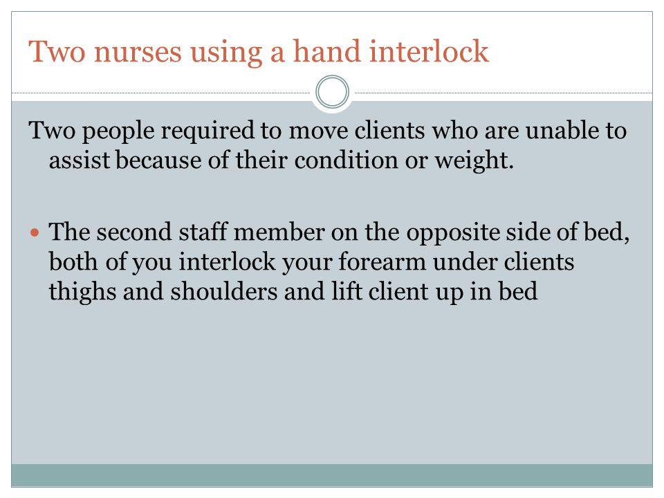Two nurses using a hand interlock