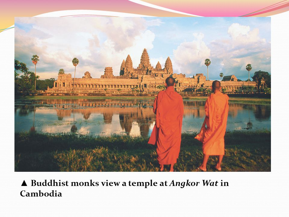 ▲ Buddhist monks view a temple at Angkor Wat in Cambodia