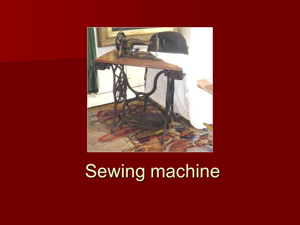 This sewing machine works by pressing the metal pedal underneath; this turns the wheel, which moves the needle up and down.