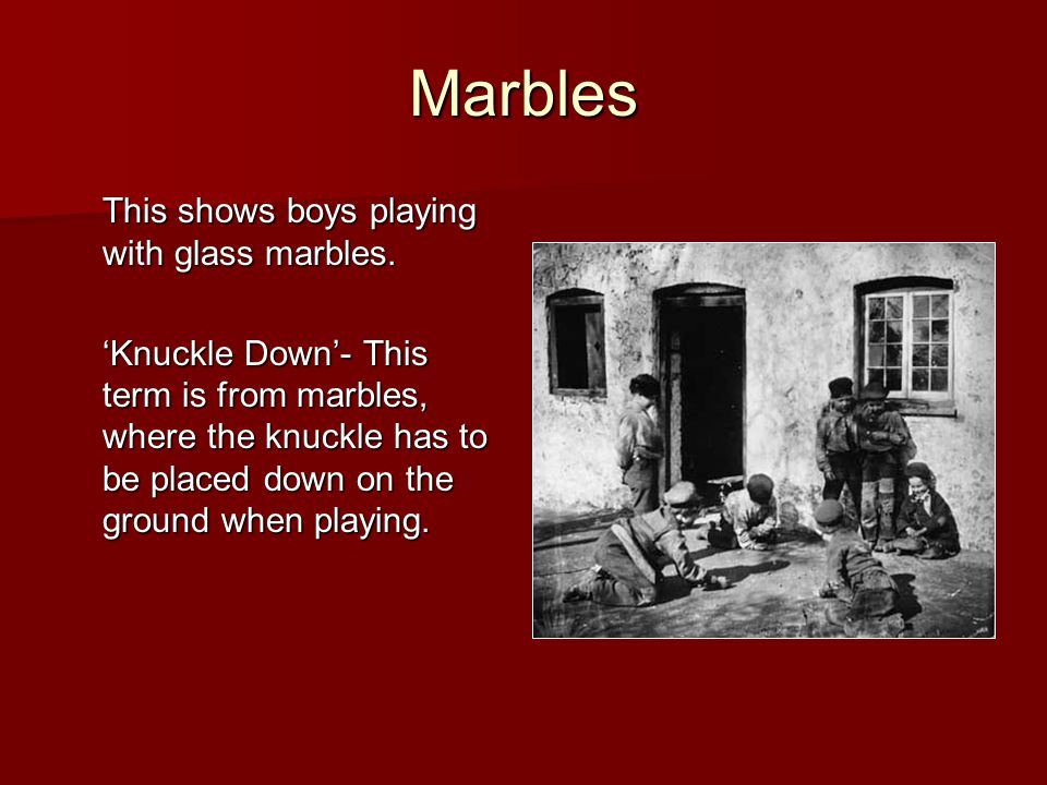 Marbles This shows boys playing with glass marbles.