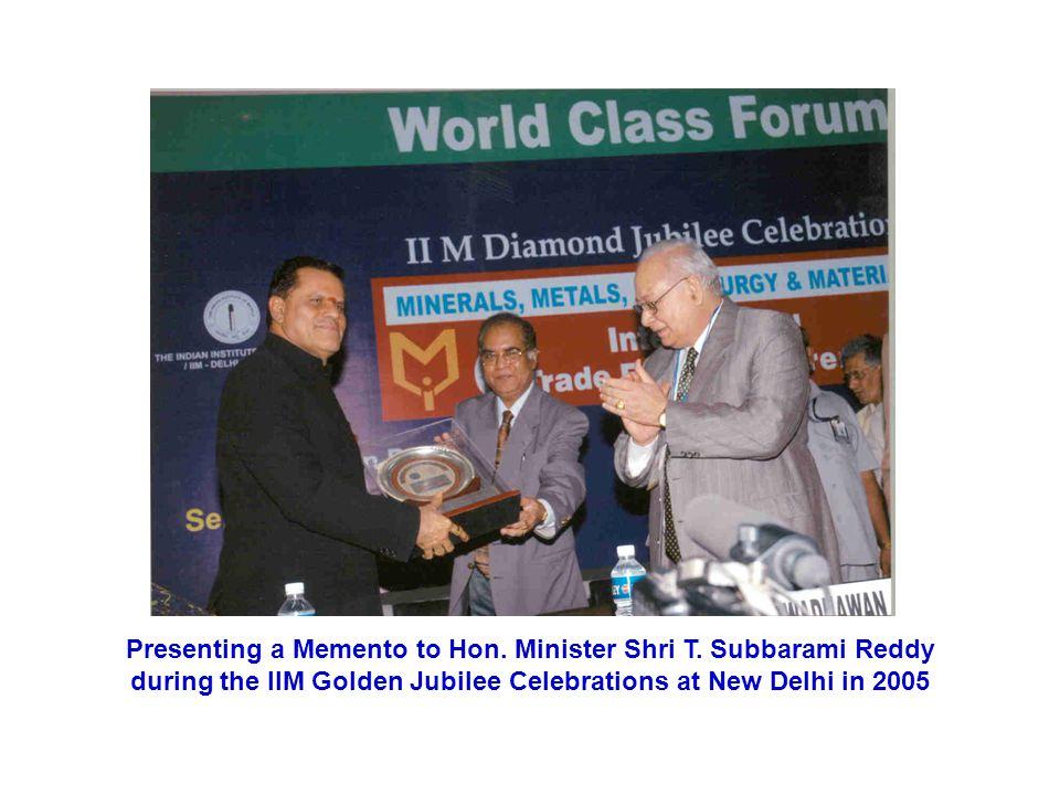 Presenting a Memento to Hon. Minister Shri T
