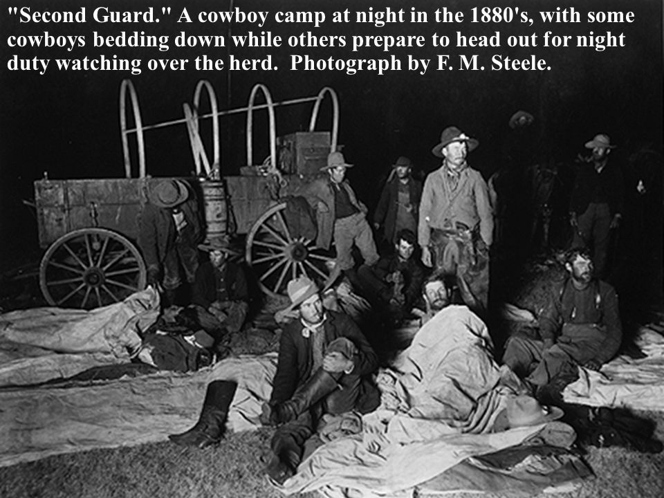Second Guard. A cowboy camp at night in the 1880 s, with some cowboys bedding down while others prepare to head out for night duty watching over the herd.
