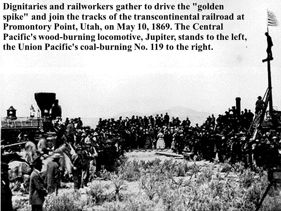 Dignitaries and railworkers gather to drive the golden spike and join the tracks of the transcontinental railroad at Promontory Point, Utah, on May 10, 1869.