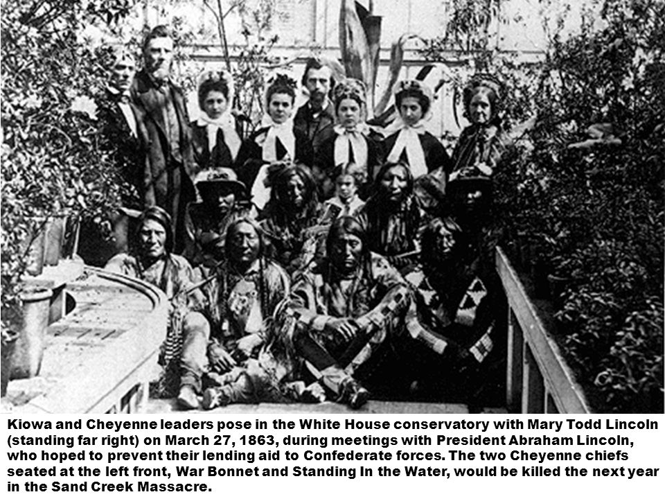 Kiowa and Cheyenne leaders pose in the White House conservatory with Mary Todd Lincoln (standing far right) on March 27, 1863, during meetings with President Abraham Lincoln, who hoped to prevent their lending aid to Confederate forces.