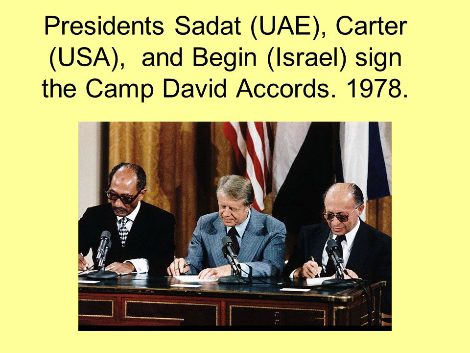 Presidents Sadat (UAE), Carter (USA), and Begin (Israel) sign the Camp David Accords. 1978.