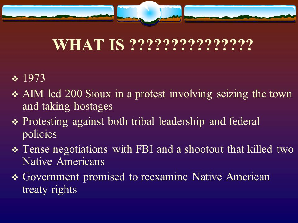 WHAT IS 1973. AIM led 200 Sioux in a protest involving seizing the town and taking hostages.