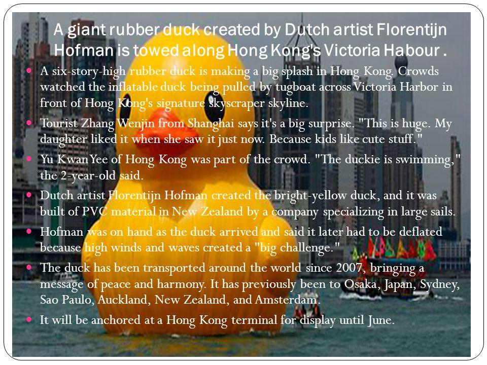 A giant rubber duck created by Dutch artist Florentijn Hofman is towed along Hong Kong s Victoria Habour .