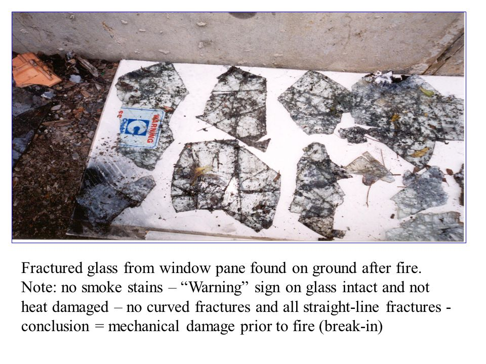 Fractured glass from window pane found on ground after fire