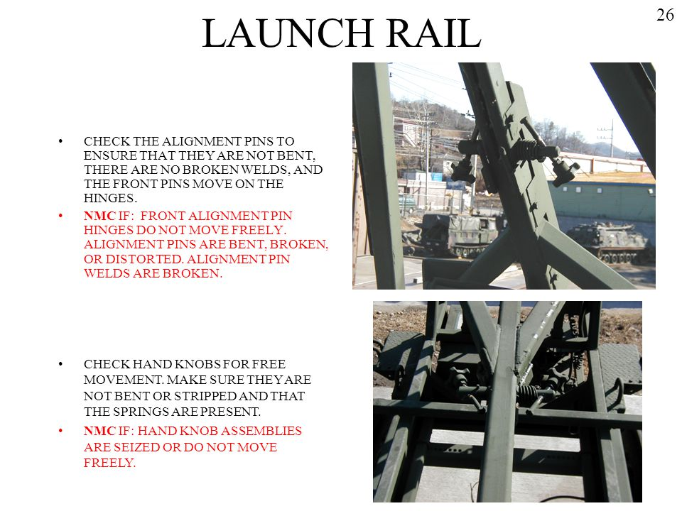 LAUNCH RAIL 26. CHECK THE ALIGNMENT PINS TO ENSURE THAT THEY ARE NOT BENT, THERE ARE NO BROKEN WELDS, AND THE FRONT PINS MOVE ON THE HINGES.