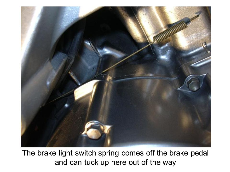 The brake light switch spring comes off the brake pedal and can tuck up here out of the way