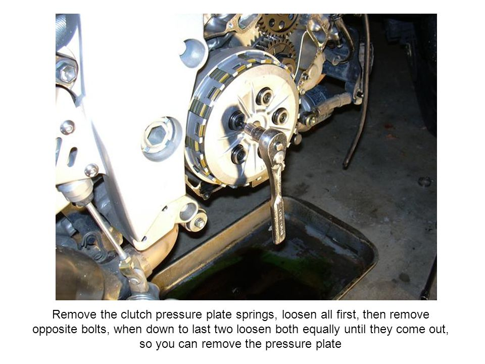 Remove the clutch pressure plate springs, loosen all first, then remove opposite bolts, when down to last two loosen both equally until they come out, so you can remove the pressure plate