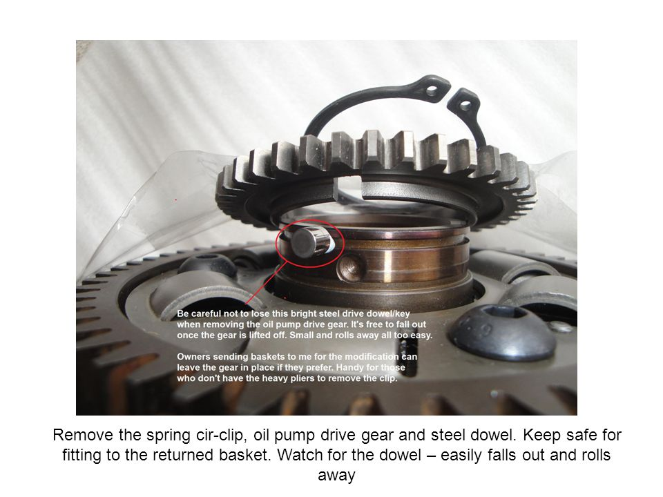 Remove the spring cir-clip, oil pump drive gear and steel dowel