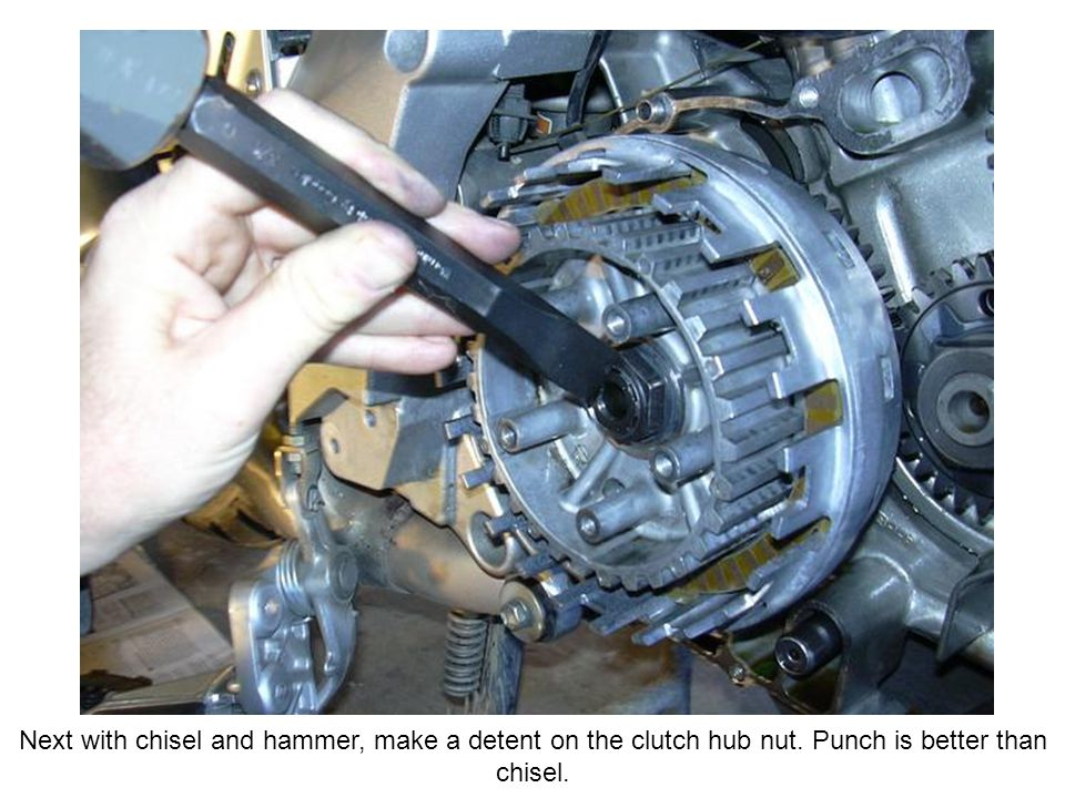 Next with chisel and hammer, make a detent on the clutch hub nut