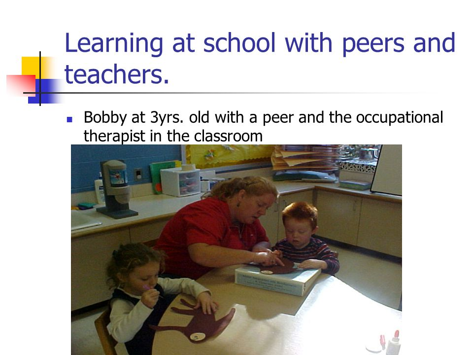 Learning at school with peers and teachers.