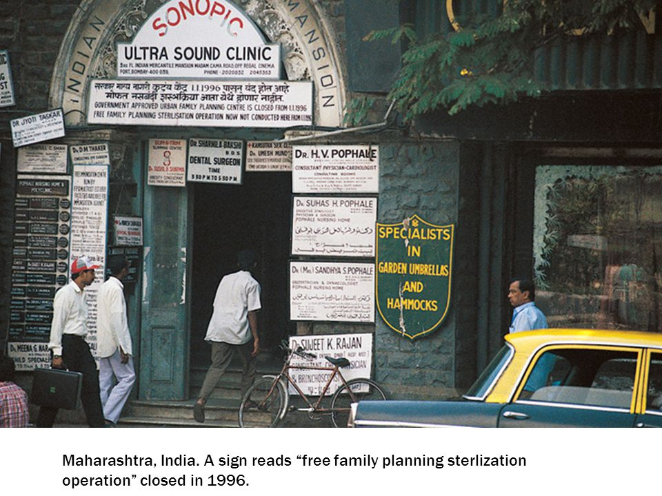Maharashtra, India. A sign reads free family planning sterlization operation closed in 1996.