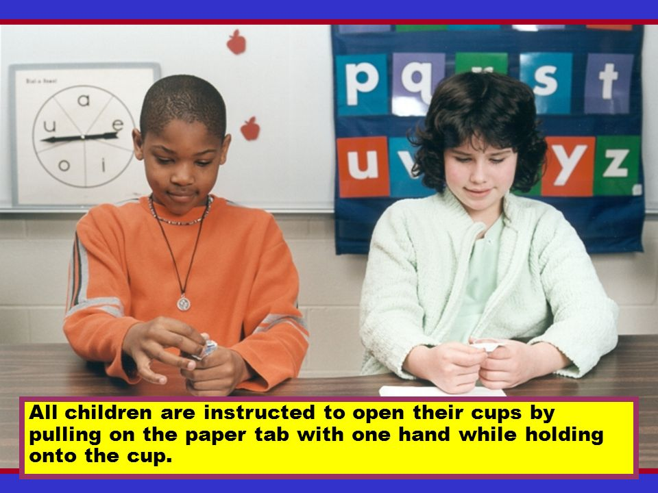 All children are instructed to open their cups by pulling on the paper tab with one hand while holding onto the cup.