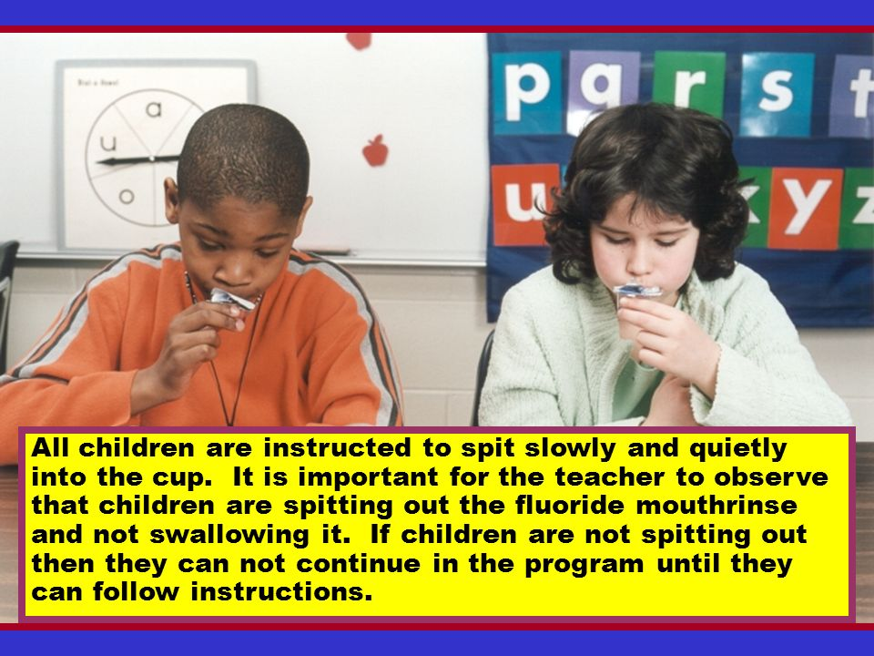 All children are instructed to spit slowly and quietly into the cup