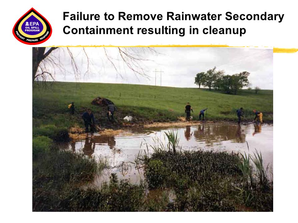 Failure to Remove Rainwater Secondary Containment resulting in cleanup
