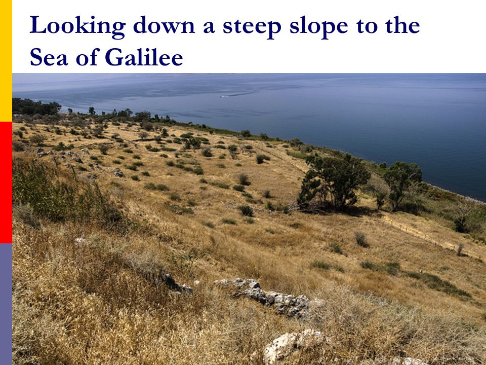 Looking down a steep slope to the Sea of Galilee