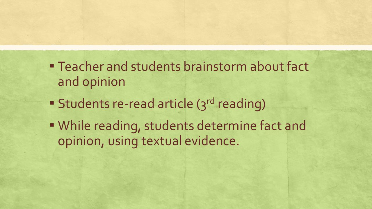 Teacher and students brainstorm about fact and opinion