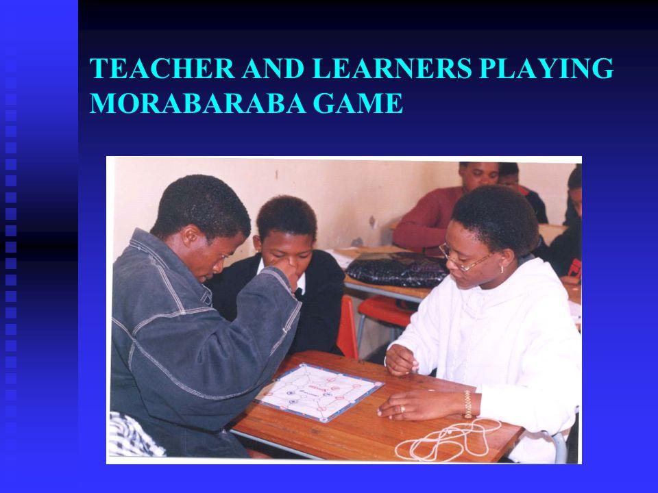 TEACHER AND LEARNERS PLAYING MORABARABA GAME