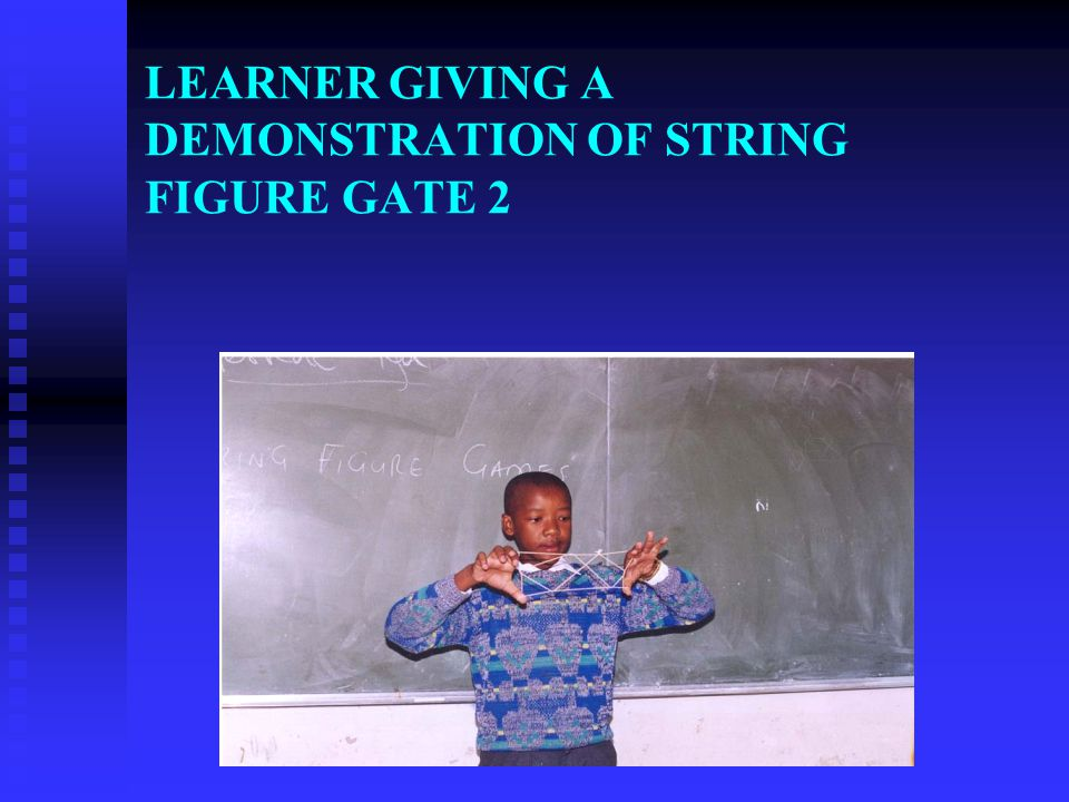LEARNER GIVING A DEMONSTRATION OF STRING FIGURE GATE 2
