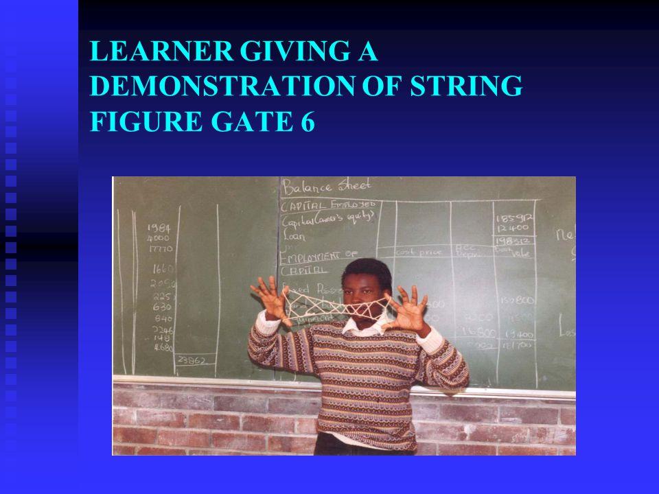 LEARNER GIVING A DEMONSTRATION OF STRING FIGURE GATE 6