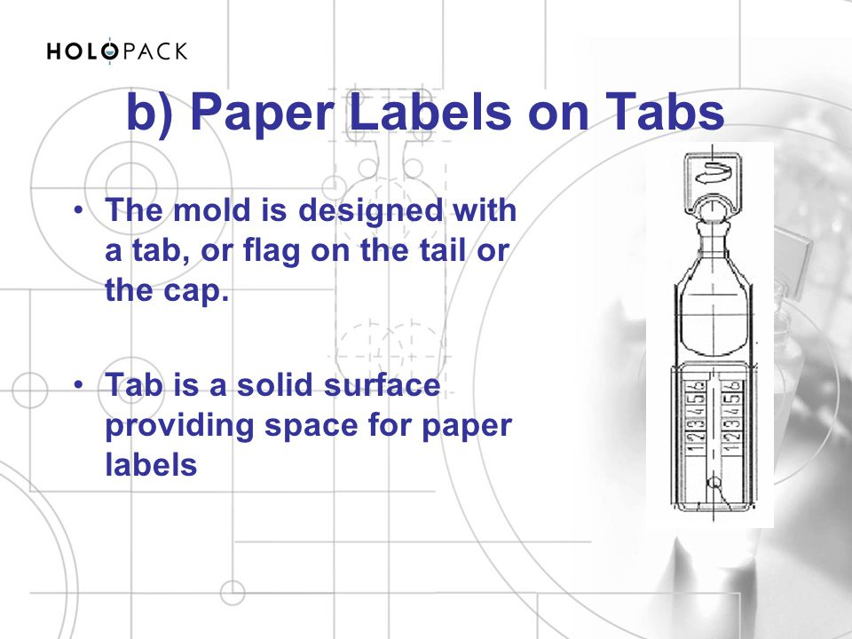 b) Paper Labels on Tabs The mold is designed with a tab, or flag on the tail or the cap.