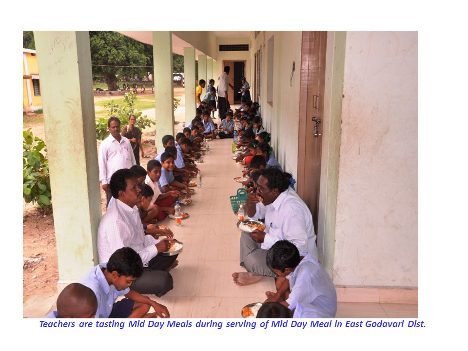 Teachers are tasting Mid Day Meals during serving of Mid Day Meal in East Godavari Dist.