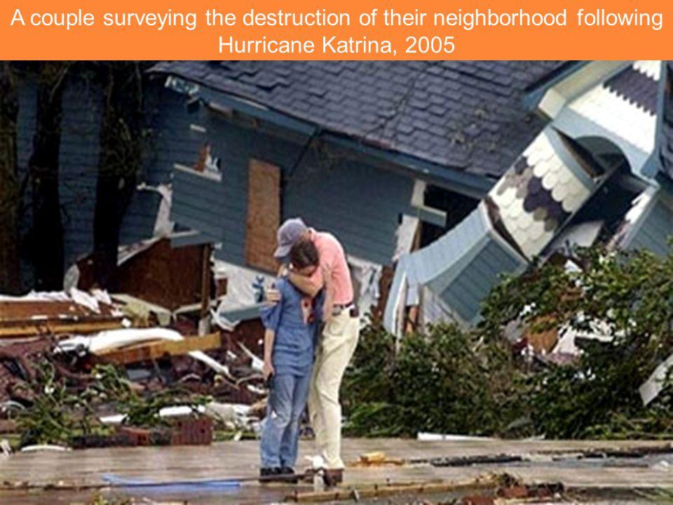 A couple surveying the destruction of their neighborhood following Hurricane Katrina, 2005