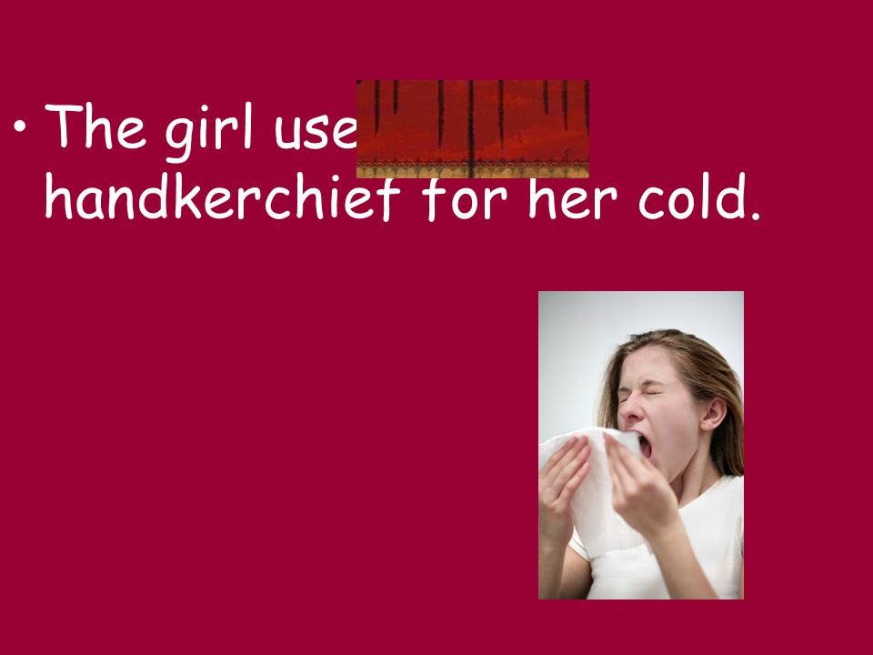 The girl used a handkerchief for her cold.