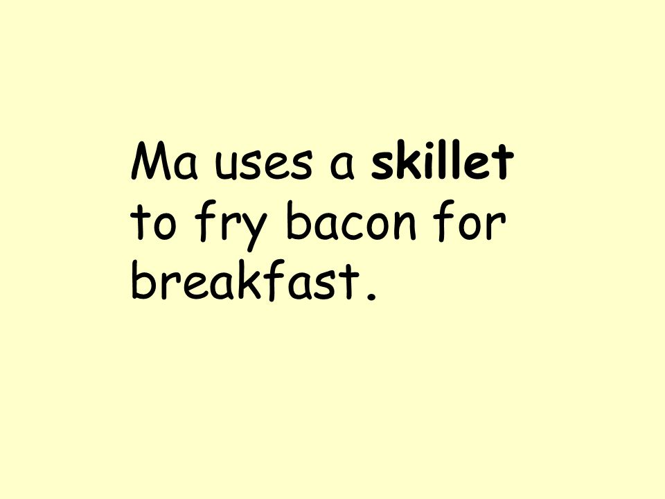 Ma uses a skillet to fry bacon for breakfast.