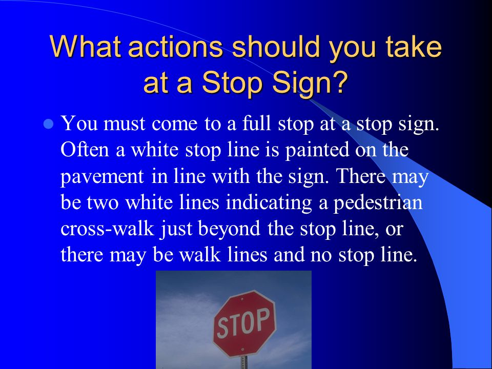 What actions should you take at a Stop Sign