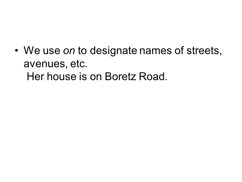 We use on to designate names of streets, avenues, etc