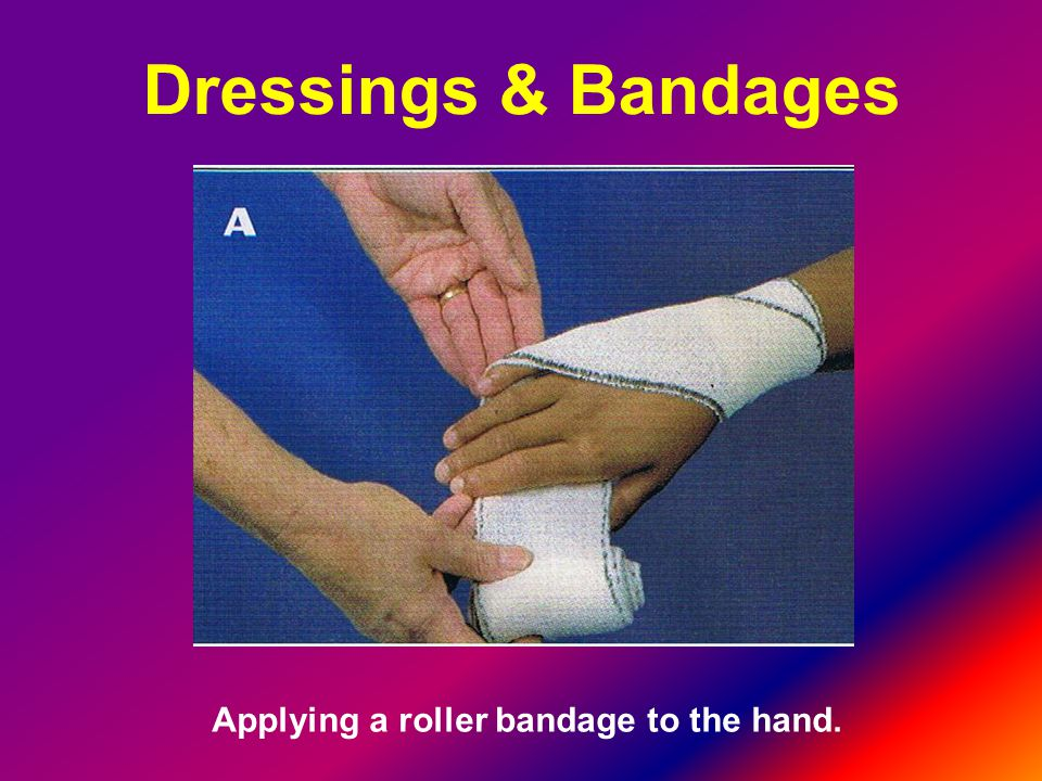 Applying a roller bandage to the hand.