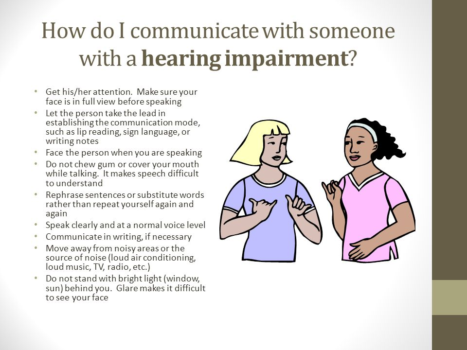 How do I communicate with someone with a hearing impairment