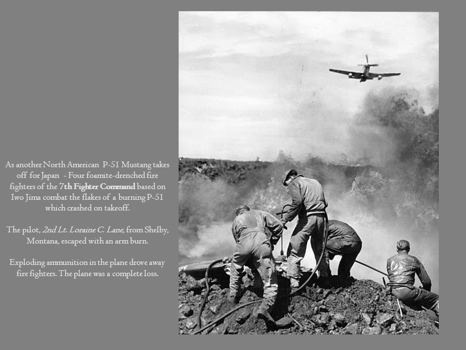 As another North American P-51 Mustang takes off for Japan - Four foamite-drenched fire fighters of the 7th Fighter Command based on Iwo Jima combat the flakes of a burning P-51 which crashed on takeoff.