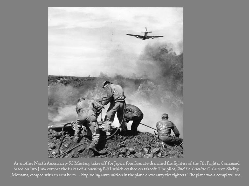 As another North American p-51 Mustang takes off for Japan, four foamite-drenched fire fighters of the 7th Fighter Command based on Iwo Jima combat the flakes of a burning P-51 which crashed on takeoff.