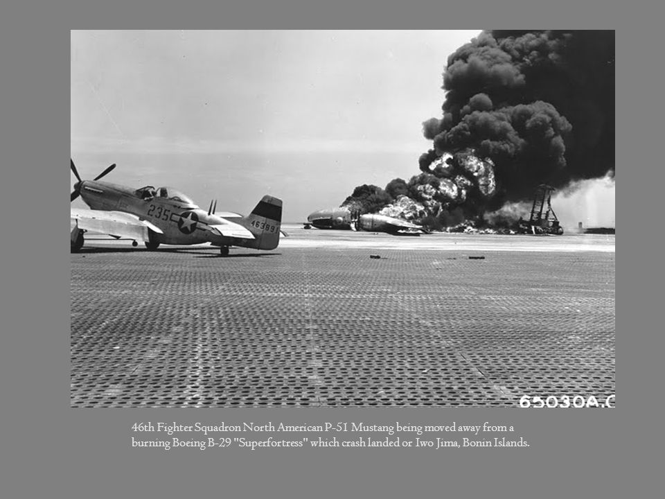 46th Fighter Squadron North American P-51 Mustang being moved away from a burning Boeing B-29 Superfortress which crash landed or Iwo Jima, Bonin Islands.