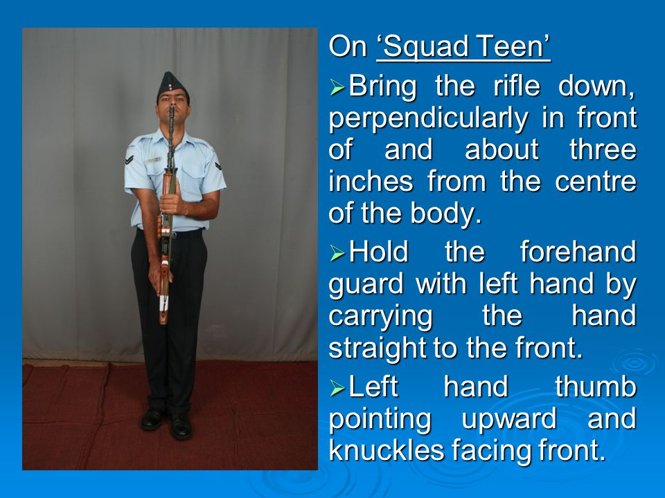 On 'Squad Teen' Bring the rifle down, perpendicularly in front of and about three inches from the centre of the body.