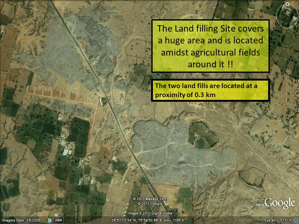 The Land filling Site covers a huge area and is located amidst agricultural fields around it !!