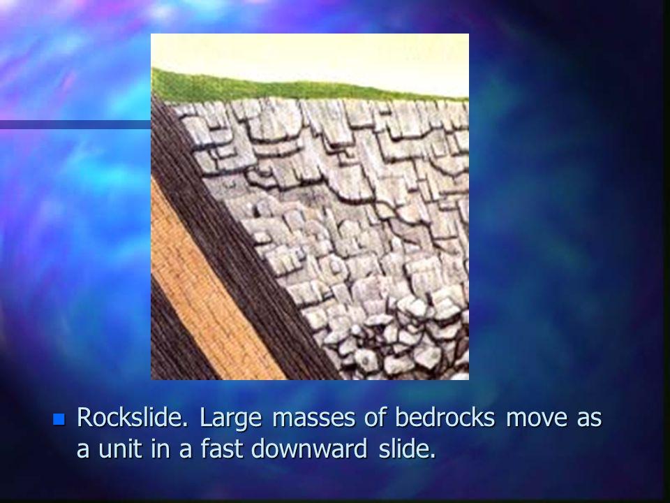 Rockslide. Large masses of bedrocks move as a unit in a fast downward slide.