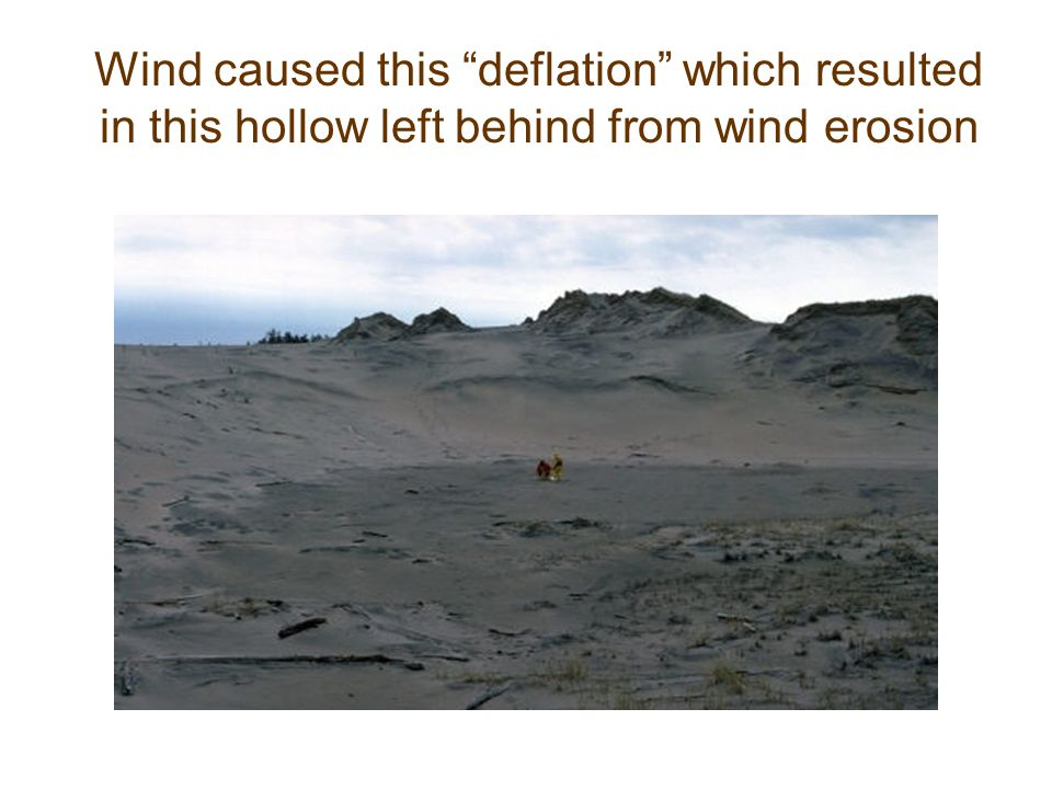 Wind caused this deflation which resulted in this hollow left behind from wind erosion