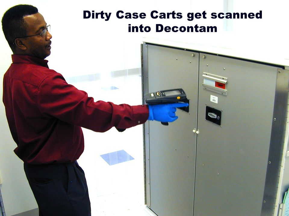 Dirty Case Carts get scanned into Decontam