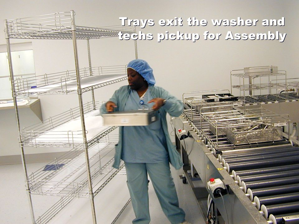 Trays exit the washer and techs pickup for Assembly